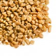 Fenugreek seeds isolated on white - Stock Photo