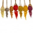 Assortment of powder spices on spoons isolated on a white background — Stock Photo #14481153