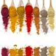 Assortment of powder spices on spoons isolated on a white background — Stock Photo #14481173