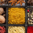 Powder spices in wooden box - Stock Photo