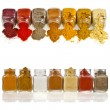 Royalty-Free Stock Photo: Powder colorful spices in glass jar on white