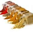 Powder colorful spices in glass jar on white — Stock Photo #14481507