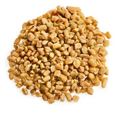 Fenugreek seeds isolated on white — Stock Photo