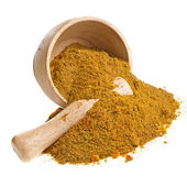 Mortar with curry powder spice isolated on white — Stock Photo