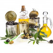 Olives fruits canned and olive oil in decanter on white background — Stock Photo