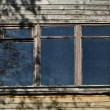 Old window on wooden wall — Stock Photo