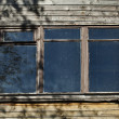 Old window on wooden wall - Stock Photo