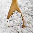 Wooden spoon full of white granular culinary sugar — Stock Photo #14871179