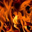 Stock Photo: Fire on black