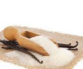Aromatic vanilla sugar on sackcloth isolated on white background — Stock Photo