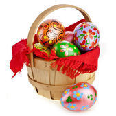 Painted colorful easter eggs in wooden basket — Stock Photo
