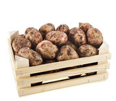 Young potatoes in a wooden box isolated on white — Stock Photo
