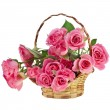 Bouquet pink roses in a basket isolated on white background - Foto Stock