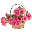 Bouquet pink roses in a basket isolated on white background - Stok fotoğraf