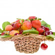 Ripe fruit and berry in the basket isolated on white — Stock Photo