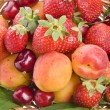 Fresh fruits and berries background - Stock Photo