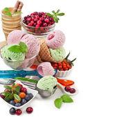 Ice cream with fresh berries on white — Stock Photo