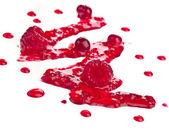 Red berries jam splash isolated on white surface — Stock Photo