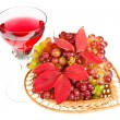Red grapes with glass wine on white background - Stock Photo