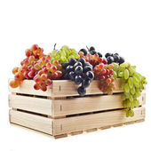 Colorful mixed grapes in a wooden box crate isolated on a white background — Stock Photo