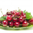 Cherries on glass bowl isolated on white background - Stock Photo