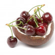 Cherry dessert in coconut bowl isolated on white background - Stock Photo