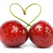 Two cherries tied together in a heart — Stock Photo #15409843