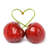 Two cherries tied together in a heart — Stock Photo