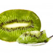 Slice kiwi in a teaspoon isolated on the white background — Stock Photo #15412721