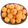Apricots in the basket isolated on white - Stock Photo