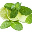Fresh slices lime with leaf mint isolated - Stock Photo