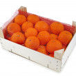 Ripe orange mandarines in wooden box isolated on white — Stock Photo