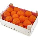 Ripe orange mandarines in wooden box isolated on white — Stock Photo #15415531