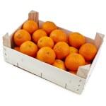 Ripe orange mandarines in wooden box isolated on white — Stock Photo #15415533