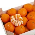Ripe orange mandarines in wooden box isolated on white — Stock Photo #15415575
