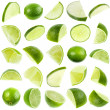 Slices green lime isolated on white background — Stock Photo #15415693