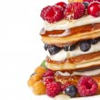 Stock Photo: Pancakes stack with fresh berries on white background