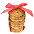 Cookies with red bow isolated on white — Stock Photo