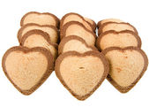 Sweet biscuits cookies in shape of hearts isolated — Stock Photo