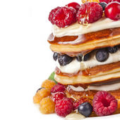 Pancakes stack with fresh berries on white background — Stock Photo