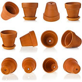 Terracotta clay flowerpots isolated on white — Stock Photo