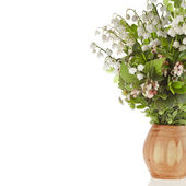 Bouquet of lilies-of-the-valle y with bloom blueberries cowberries on wooden vase — Stock Photo