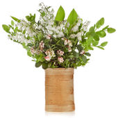 Bouquet of lilies-of-the-valle y with bloom blueberries cowberries on birch vase — Stock Photo