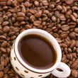 Coffee cup and grain - Stock Photo