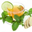 Ginger tea with lime and mint isolated over white background - Stock Photo