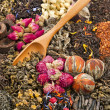 Different tea types: green, black, chinese, floral, herbal rooibos with bamboo spoon — Stock Photo #15868893