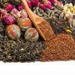 Different tea types: green, black, chinese, floral, herbal rooibos with bamboo spoon — Stock Photo #15868903