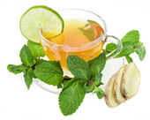 Ginger tea with lime and mint isolated over white background — Stock Photo