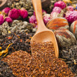 Different tea types: green, black, chinese, floral, herbal rooibos with bamboo spoon — Stock Photo #15886121