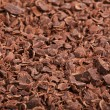 Chocolate shavings close up surface texture — Stock fotografie
